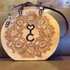 Custom-made bag with brand and floral carving.