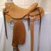 "Saddle #4514.  58 Wade tree, 15 1/2"" seat, all rough out.  Flat plate rigging, wood post horn 3 1/4"" high x 5"".  Cheyenne roll."