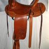 "#0903; Modified Assoc. Tree, 12"" swell, 15 1/2"" seat, 4 1/2"" cantle; Boy horn 2 1/2"" high, 2 1/2"" cap latigo wrapped; flat plate rigging, 3"" leather-covered Visalia stirrups, partial flower carved."