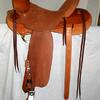 "#2207; 58 Wade Tree, 16"" seat, wood post horn 2 1/2"" high, 3 1/4"" cap mule hide wrapped, rawhide bound; 4 1/2"" cantle Cheyenne roll, rough-out seat & fenders, gullet skirts & rear jockeys smooth, 7/8 flat plate rigging, saddle bags, 4"" wood tin-bound bell stirrups."