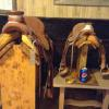 Sitting beside a full-size saddle with a pop can to give a sense of the size.