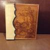 photo album, bucking horse with floral carving