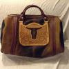 Dark & light brown hair-on bag, floral carved overlay with cut-out steer head, no side pocket.